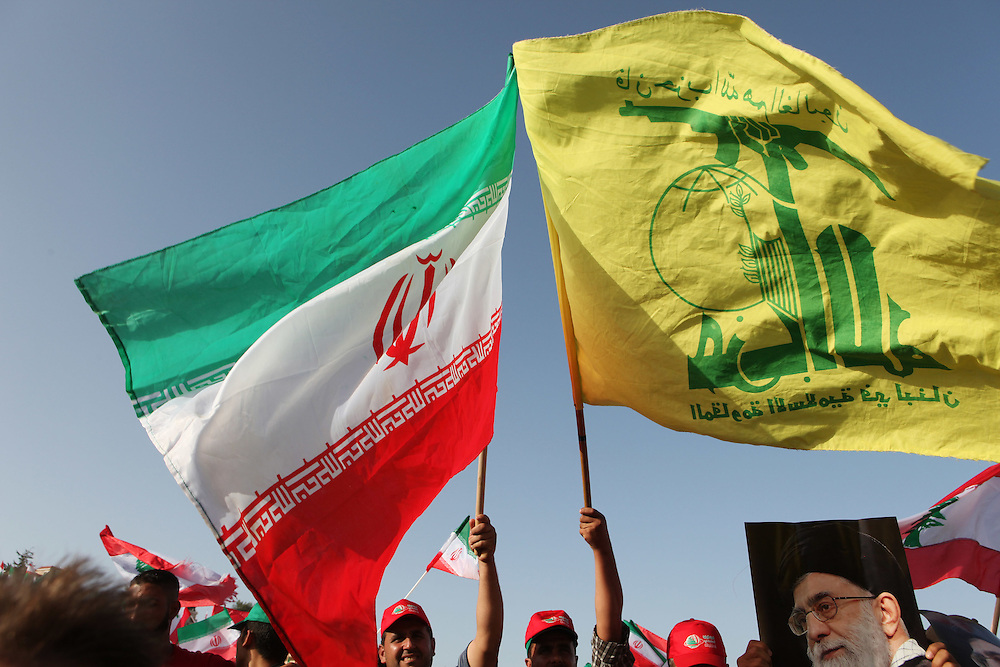 On the second and final day of his visit to Lebanon, Iranian President Mahmoud Ahmadinejad traveled to the southern town of Bint Jbeil. There a Hizballah-organized rally was held to welcome Ahmadinejad to the south Lebanon, an area where Hizballah is widely supported. Tens of thousands gathered for hours holding flags of Iran, Hizballah, Lebanon and other political parties, cheering the Iranian president as he arrived by helicopter from Beirut. ///People wave Hizballah and Iranian flags at a stadium in Bint Jbeil waiting for Iranian President Mahmoud Ahmadinejad to address the crowd.