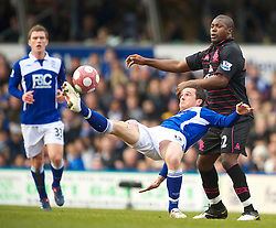 BIRMINGHAM, ENGLAND - Saturday, March 13, 2010: Everton's Ayegbeni Yakubu and Birmingham City's Barry Ferguson during the Premiership match at St Andrews. (Photo by David Rawcliffe/Propaganda)