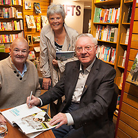 Caimen Jones and his sister Anne Jones, getting their book signed at the launch of Donncha O Dúlaing new book at Ennis Bookshop