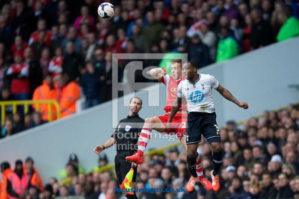 Danny Rose of Tottenham Hotspur wind the header from Calum Chambers of Southampton during the Barclays Premier League match at White Hart Lane, London<br /> Picture by Alan Stanford/Focus Images Ltd +44 7915 056117<br /> 23/03/2014