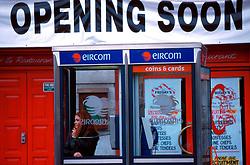 IRELAND DUBLIN MAR00 - Two Dubliners talk inside phone boxes of Ireland's newly created Eircom Telecoms company, formerly known as Irish Telecom. .. jre/Photo by Jiri Rezac. . © Jiri Rezac 2000. . Tel:   +44 (0) 7050 110 417. Email: info@jirirezac.com. Web:   www.jirirezac.com