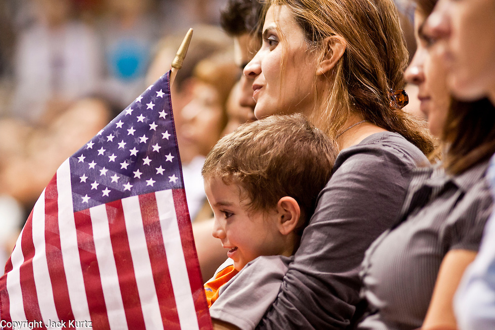"July 2 - PHOENIX, AZ: ROUBA KHARMA and her son, OMAR EL ASSADI, both originally from Syria, become US citizens Friday. Nearly 200 people were sworn in as US citizens during the ""Fiesta of Independence"" at South Mountain Community College in Phoenix, AZ, Friday. The ceremony is an annual event on th 4th of July weekend and usually the largest naturalization ceremony of the year in the Phoenix area.  Photo by Jack Kurtz"