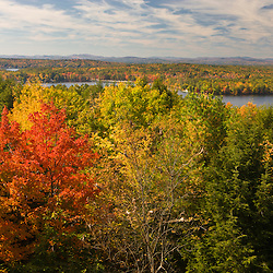 A view of fall foliage and Lake Winnepesauke from Abenaki Lookout Tower in Tuftonboro, New Hampshire.