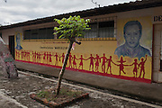 Mural outside the Cultural Center in San Isidro, Cabañas, depicts the images of murdered human rights activists Monsignor Oscar Romero (left) and local environmental leader Marcelo Rivera. Active against the implementation of Pacific Rim's El Dorado open pit gold mine in the area, Marcelo Rivera was a vocal activist who disappeared on June 18, 2009. His body was found inside a well nearly two weeks later with signs of torture. Pacific Rim's controversial El Dorado gold mine has been the focus of numerous social conflicts at local and national level. Three anti-mining local leaders, including Rivera, were murdered in 2009. While a year before, former president Antonio Saca refused to authorize the company's mining permit. This action prompted Pacific Rim to invoked a provision of the Central American Free Trade Agreement (CAFTA) to place the matter in the hands of an international arbitration court. Oceana Gold, who took over Pacific Rim on October 2013 for US $10.2 million , now seeks US $300 million for damages agains the State of El Salvador. San Isidro, Cabañas, El Salvador. September 15, 2014.