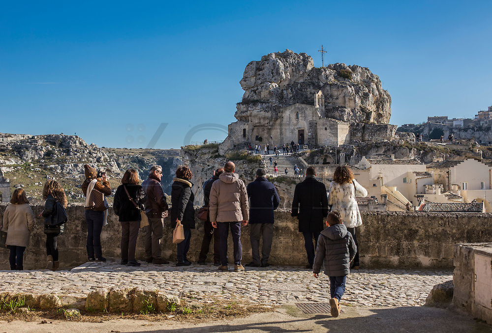 Tourists visiting Sassi di Matera. View os S. Maria de Idris