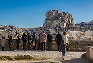 Tourists visiting Sassi di Matera. View os S. Maria de Idris