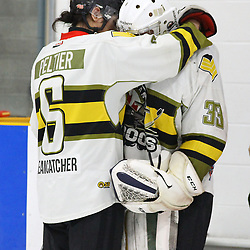 TRENTON, ON  - MAY 5,  2017: Canadian Junior Hockey League, Central Canadian Jr. &quot;A&quot; Championship. The Dudley Hewitt Cup Game 7 between Georgetown Raiders and the Powassan Voodoos.    Bo Peltier #6 of the Powassan Voodoos hugs  Nate McDonald #33 of the Powassan Voodoos post game.<br /> (Photo by Alex D'Addese / OJHL Images)