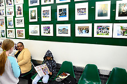 Egypt, 7, reads a book at the laundry library while waiting at the laundromat owned and operated by James Betterson, in NorthEast Philadelphia, on February 15 2019. (Bastiaan Slabbers for WHYY)