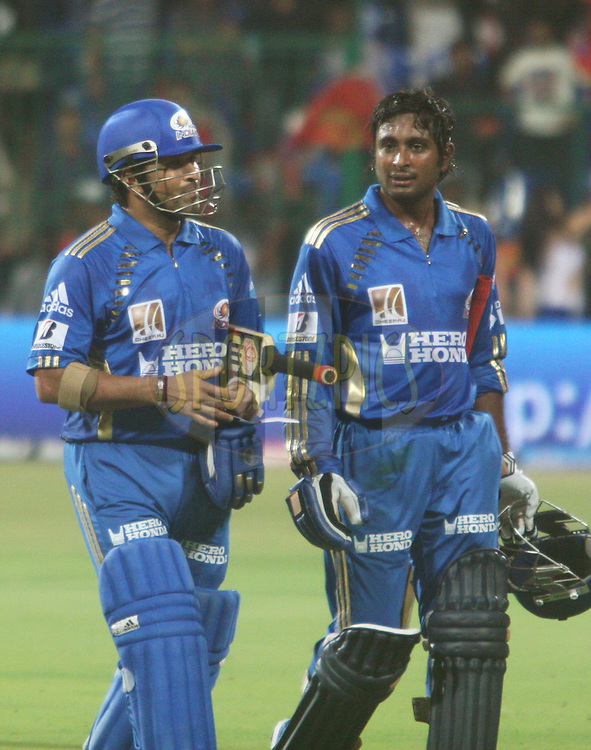 Sachin Tendulkar (left) and Ambati Rayudu who jointly won the 'Man of the Match' award returning to the pavilion after their match winning knock in the match 8 of the the Indian Premier League ( IPL ) Season 4 between the Royal Challengers Bangalore and the Mumbai Indians held at the Chinnaswamy Stadium, Bangalore, Karnataka, India on the 12th April 2011..Photo by Vino John/BCCI/SPORTZPICS