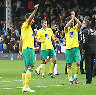 Picture by Paul Chesterton/Focus Images Ltd.  07904 640267.31/03/12.Russell Martin of Norwich and Andrew Surman of Norwich show their appreciation to the traveling support at the end of the Barclays Premier League match at Craven Cottage stadium, London.
