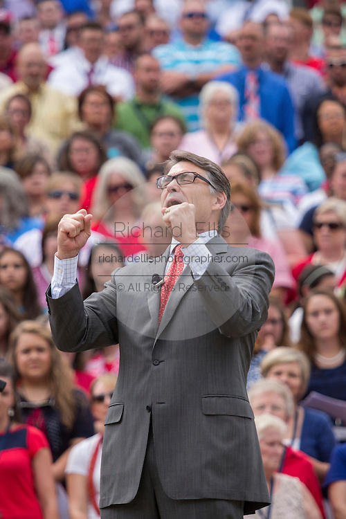 "Former Texas Gov. Rick Perry address a gathering of evangelical Christians during the ""Stand With God"" rally  August 29, 2015 in Columbia, SC. Thousands of conservative Christians gathered at the State House to rally against gay marriage and listen to GOP presidential candidates Gov. Rick Perry and Sen. Ted Cruz speak."
