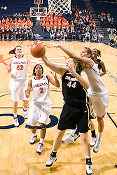 Virginia forward Chelsea Shine (50) battles with Colorado center Kara Richards (44) for a rebound.  The #16 ranked Virginia Cavaliers women's basketball team defeated the Colorado Buffaloes 77-43 at the John Paul Jones Arena on the Grounds of the University of Virginia in Charlottesville, VA on November 24, 2008.