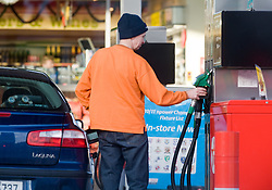 © London News Pictures. 06/01/2011. FILE PICTURE. A  Motorist filling his car with petrol in London. Workers should expect another year of pain, with pay freezes or pay rises well below inflation, researchers have claimed. People are already struggling to make ends meet on their current salary, particularly following the recent rises in VAT and petrol prices. Photo credit should be read: London News Pictures....Motorists were queueing for petrol at a Hertford petrol station on the A414 on Christmas Eve before travelling on Christmas Day.