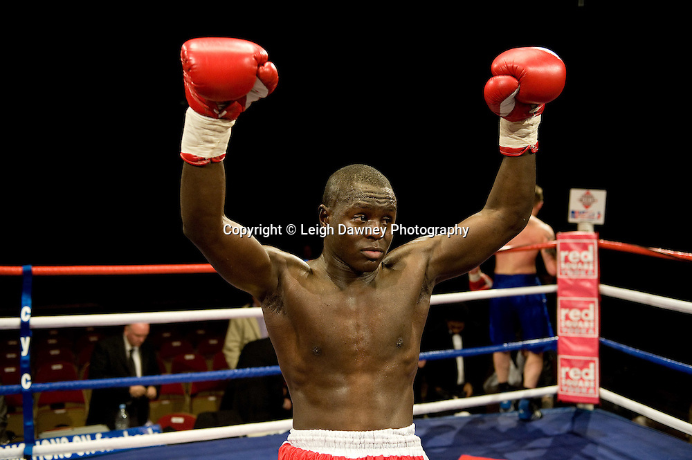 Erick Ochieng (red shorts) defeats Jon Harrison at Brentwood Centre 22nd January 2010, Frank Maloney Promotions,Credit: © Leigh Dawney Photography
