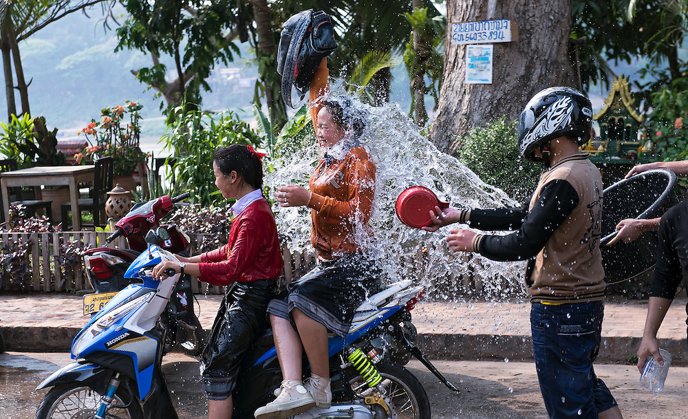 Girls have water thrown over them during the Lao New Year celebrations in Luang Prabang, Laos.