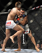 "LAS VEGAS, NEVADA, MAY 24, 2008: Dong Hyun Kim (left) throws a knee strike to the thigh of Jason Tan during ""UFC 84: Ill Will"" inside the MGM Grand Garden Arena in Las Vegas"