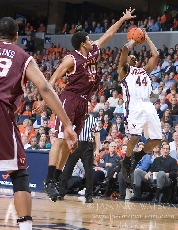 Virginia Cavaliers point guard Sean Singletary (44) shoots a fadeaway jump shot over Virginia Tech Hokies forward A.D. Vasallo (40).  The Virginia Cavaliers Men's Basketball Team defeated the Virginia Tech Hokies 69-56 at the John Paul Jones Arena in Charlottesville, VA on March 1, 2007.