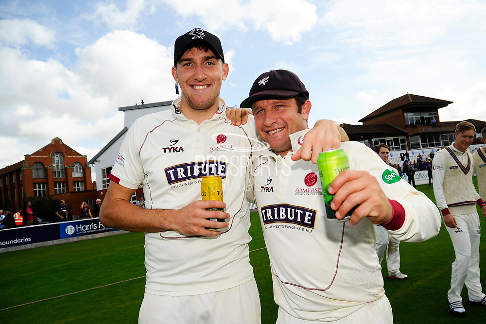 Craig Overton of Somerset and Roelof van der Merwe of Somerset on a lap of honour after beating Middlesex to secure survival in Division 1 of the Specsavers County Champ Div 1 match between Somerset County Cricket Club and Middlesex County Cricket Club at the Cooper Associates County Ground, Taunton, United Kingdom on 28 September 2017. Photo by Graham Hunt.