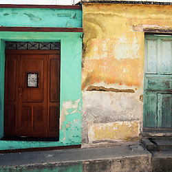 Brightly coloured walls are starting to fade on these houses in Xela, Guatemala.