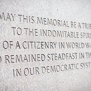"An inscription that reads ""May this memorial be a tribute to the indomitable spirit of a citizenry in World War II who remained steadfast in their faith in our democratic system,"" a quote by US Congressman and former internee Norman Mineta at the Memorial to Japanese-American Patriotism in World War II near the US Capitol in Washington DC. The memorial was designed by Davis Buckley and Nina Akamu and commemorates those held in Japanese American internment camps during World War II."