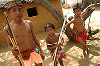 Wayuu Indian boys with their traditional bows and arrows at the annual Wayuu Cultural Festival in Uribia, Colombia June 9, 2007. (Photo/Scott Dalton)