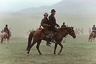 Mongolia. Horsemen from the steppe, on the outskirts of UlaanBaatar.   /  Cavaliers de la steppe à la sortie de Oulan bator