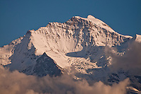 Berner Oberland, Switzerland. Close-up of the Jungfrau swirled in cloud in the late afternoon.