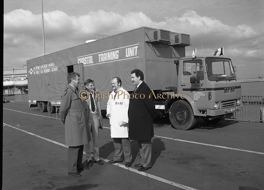 B.I.M.Training Vehicle.  (R31)..1986..11.04.1986..04.11.1986..11th April 1986..B.I.M's Coastal training unit left Ireland today to visit the major fishing ports of Brittany. Over the next three weeks demonstrations will be given, to French fishermen, of the types of courses provided by the board for fishermen at their home ports. Staffed by two instructors the unit offers comprehensive courses in navigation,radiotelephony, engine maintenance, electrical systems,Hydraulics and refrigeration. This endeavour is funded by the E.E.C. Commission...Image shows (L-R) Dr Tony Meaney, Chief Executive,B.I.M.,Tom Kelly, Declan O'Connor (instructors) and Mr Michael Budds, B.I.M., Advisory Service at the training vehicle at Dún Laoighaire.
