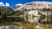 Hiker on the shore of Big Pine Lake #4, John Muir Wilderness, Sierra Nevada Mountains, California USA