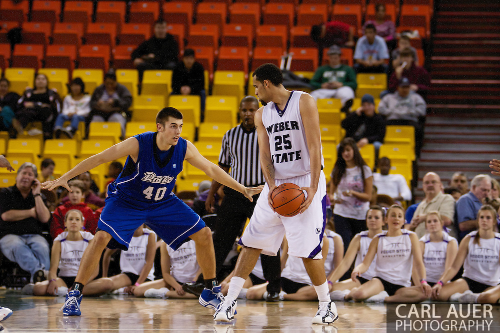 November 27th, 2010:  Anchorage, Alaska - Weber State freshman forward Byron Fulton (25) looks for a opening in the Weber State 82-81 victory over the Drake Bulldogs in the third place game of the Great Alaska Shootout.