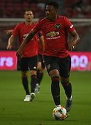 Manchester United's Anthony Martial runs at the Inter Milan defence during an International Champions Cup game won by Manchester United 1-0, Saturday, July 20, 2019, in Singapore. (Kim Teo/Image of Sport)