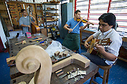 "Impromptu concert by instrument builders at Acade?mico de Lutheri?a, the main instrument making and repair facility of.the ""Fundacion del Estado para el Sistema Nacional de las Orquestas Juveniles e Infantiles de Venezuela"" (FESNOJIV, National Network of Youth and Children Orchestras of Venezuela). This organisation is also known as El Sistema, a publicly financed private-sector music-education program in Venezuela, originally called Social Action for Music, founded 1975 by Venezuelan economist and amateur musician Jose? Antonio Abreu."