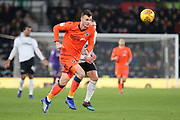 Millwall defender Jake Cooper keeps his eyes on the ball during the EFL Sky Bet Championship match between Derby County and Millwall at the Pride Park, Derby, England on 20 February 2019.