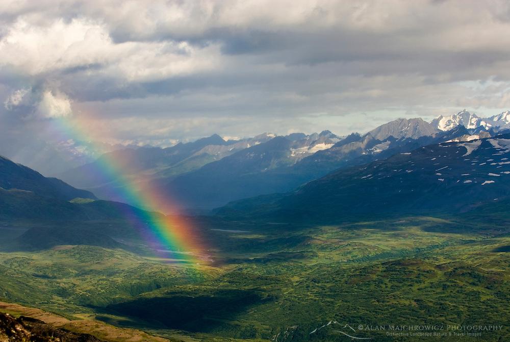 Rainbow over peaks of the Chugach Mountains near Thompson Pass Alaska USA