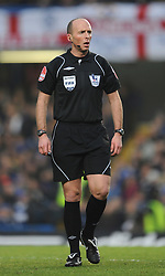 LONDON, ENGLAND - Sunday, February 7, 2010: Referee Mike Dean during the Premiership match at Stamford Bridge. (Photo by Chris Brunskill/Propaganda)
