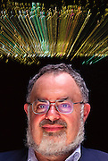 Stanton Friedman. Portrait of Stanton T. Friedman, nuclear physicist and author of books examining the UFO incident near Roswell, New Mexico, USA. He makes a living from writing and lecturing on UFOs. The Roswell incident started on 2 July 1947 when UFO sightings were reported during a thunderstorm. Next morning a rancher, Mac Brazel, discovered strange wreckage in a field. When the impact site was located, a UFO craft and alien bodies were allegedly found. On 8 July 1947, the Roswell Daily Record announced the capture of a flying saucer. The official statement was that a weather balloon had crashed. Many Roswell inhabitants, however, believe this a cover up, and that aliens arrived. Model Released (1997).
