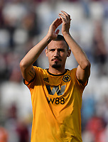 Football - 2018 / 2019 Premier League - West Ham United vs. Wolverhampton Wanderers<br /> <br /> Wolverhampton Wanderers' Leo Bonatini celebrates at the final whistle with the fans after their 1-0 victory, at The London Stadium.<br /> <br /> COLORSPORT/ASHLEY WESTERN