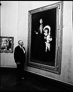Armand Hammar Collection, Exhibition..1972..09.08.1972..08.09.1972..9th August 1972..Dr Armand Hammer arrived at the National Art Gallery in Dublin to open an exhibition of his art collection. The exhibition will be open to the public until October the 1st...Image of Dr Armand Hammar posing with the portraits of Mrs Edward L Davis and her son Livingstone. The painting by world famous artist John Singer Sargent (1856 - 1925) is part of the collection loaned to the gallery by Dr Hammar.