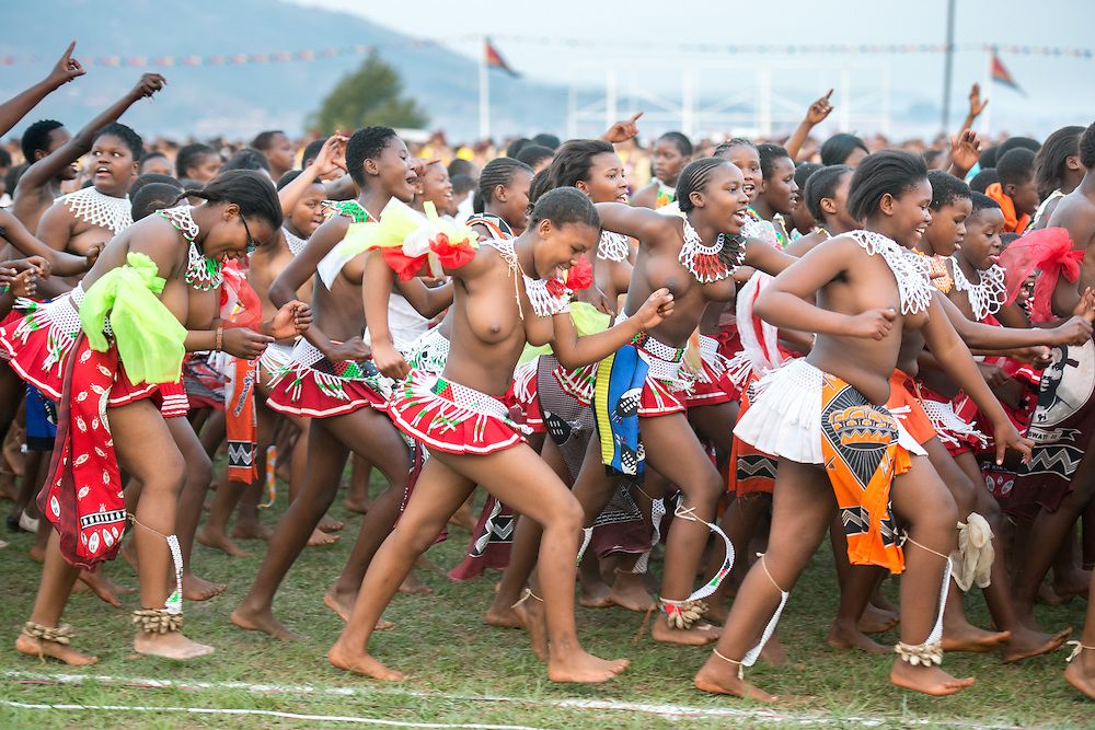 Ludzidzini, Swaziland, Africa - Annual Umhlanga, or reed dance ceremony, in which up to 100,000 young Swazi women gather to celebrate their virginity and honor the queen mother during the 8 day long event.<br /> Maidens enter the dancing grounds to perform for the royal court