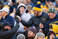 Dec 3, 2016; Morgantown, WV, USA; West Virginia Mountaineers fans celebrate in the crowd during the first quarter against the Baylor Bears at Milan Puskar Stadium. Mandatory Credit: Ben Queen-USA TODAY Sports