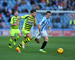 Yeovil Town's Joe Edwards attacks under pressure from Huddersfield Town's Jonathan Hogg - Photo mandatory by-line: Alex James/JMP - Tel: Mobile: 07966 386802 29/12/2013 - SPORT - FOOTBALL - John Smith's Stadium - Huddersfield - Huddersfield Town v Yeovil Town - Sky Bet Championship