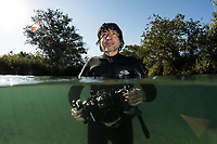 """Daniel De Granville, a local guide for experiences with the green anaconda (Eunectes murinus) in Bonito, Mato Grosso Sul, Brazil. Photographed while filming Tales by Light, Season 2, Episode 3, """"Misunderstood Predators"""", for Netflix and National Geographic Australia. August, 2016."""