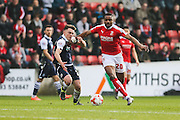 Swindon forward Jonathan Obika & Millwall FC midfielder Ben Thompson (24) battle for the ball during the Sky Bet League 1 match between Swindon Town and Millwall at the County Ground, Swindon, England on 12 March 2016. Photo by Shane Healey.