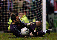 Photo: Jed Wee.<br /> Doncaster Rovers v Arsenal. Carling Cup. 21/12/2005.<br /> <br /> Arsenal goalkeeper Manuel Almunia saves from Doncaster's Paul Heffernan.
