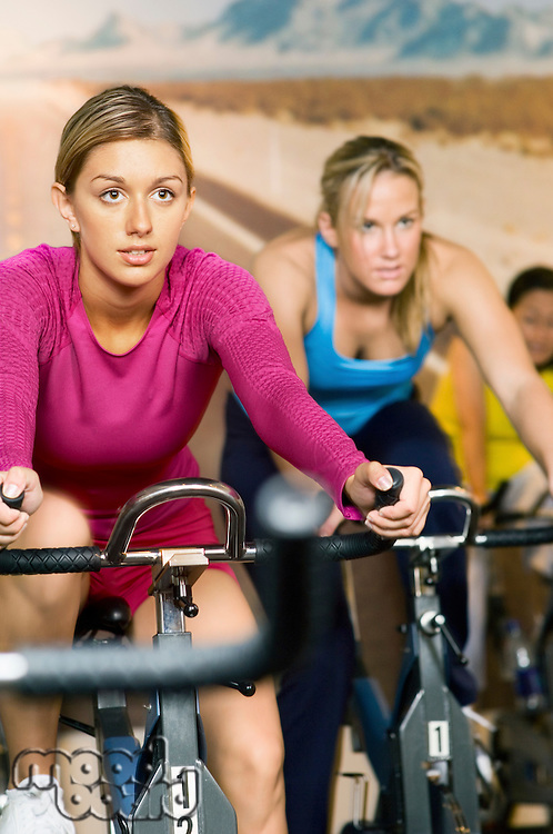 Woman using exercise bikes indoors