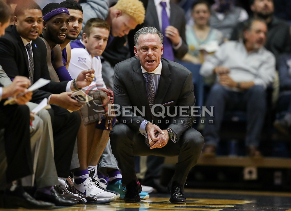 Feb 12, 2018; Morgantown, WV, USA; TCU Horned Frogs head coach Jamie Dixon squats along the bench during the first half against the West Virginia Mountaineers at WVU Coliseum. Mandatory Credit: Ben Queen-USA TODAY Sports