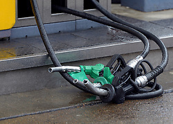 © Licensed to London News Pictures. 16/07/2012. London, UK Fuel pumps lie on the floor after being removed by protesters and locked together with bicycle locks. A shell petrol station on Uxbridge Road, West London today. Greenpeace campaigners have successfully shut down shell stations across London by removing the fuses from the emergency fuel cut off switch. Photo credit : Stephen Simpson/LNP
