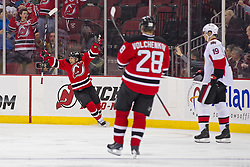 Dec 18, 2013; Newark, NJ, USA;  New Jersey Devils right wing Stephen Gionta (11) celebrates his goal during the first period of their game against the Ottawa Senators at the Prudential Center.