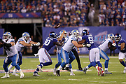 Detroit Lions offensive guard Graham Glasgow (60) blocks New York Giants outside linebacker Devon Kennard (59) while Detroit Lions offensive tackle Ricky Wagner (71) misses a block on New York Giants defensive end Jason Pierre-Paul (90) who strip sacks Detroit Lions quarterback Matthew Stafford (9) causing a fumble recovered by the Giants at their own 35 yard line in the second quarter during the 2017 NFL week 2 regular season football game against the against the New York Giants, Monday, Sept. 18, 2017 in East Rutherford, N.J. The Lions won the game 24-10. (©Paul Anthony Spinelli)