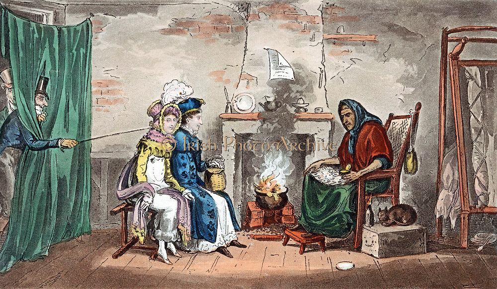 Kate and Sue having fortunes read in the cards (Cartomancy), while Tom and Jerry attract their attention.  Food is cooking in pot on fire; old woman's bed is folded against wall (right)and her pet cat sits beside her.  Illustration by IRC and G Cruikshank for Pierce Egan 'Life in London' 1821.  Aquatint